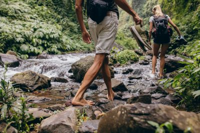 fit couple hiking barefoot