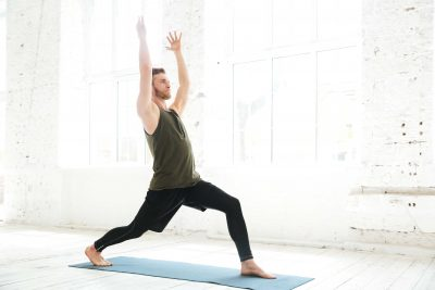 man yoga pose knee bend