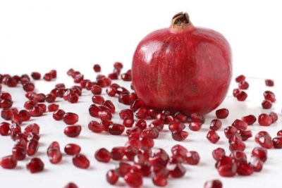 Isolated pomegranite with scattered seeds