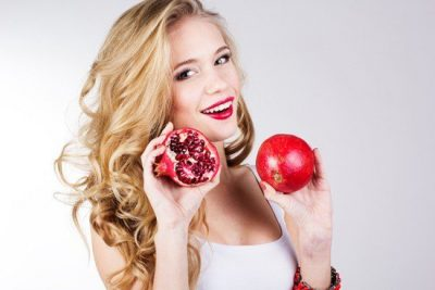 blonde-holding-pomegranates