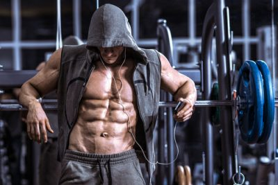 man with ripped abs in the gym has been taking Progentra