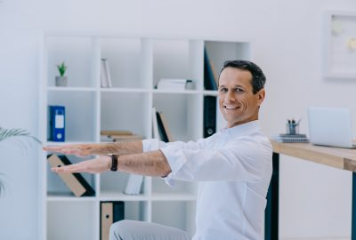 man doing exercise in the office with more energy