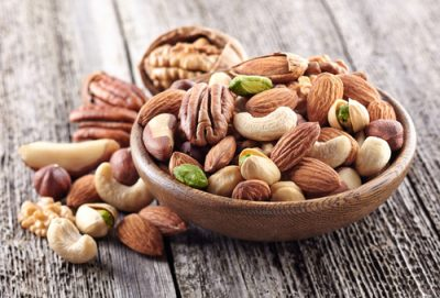 mixed nuts snack in wooden bowl, walnut, almond, cashew