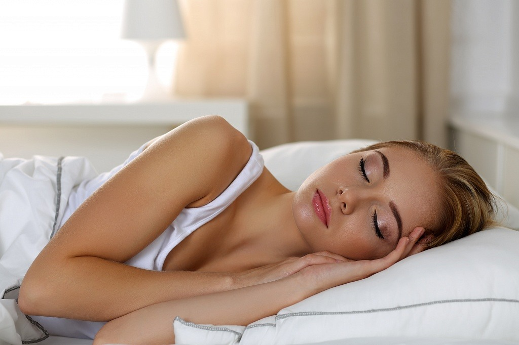 woman peacefully sleeping in bed