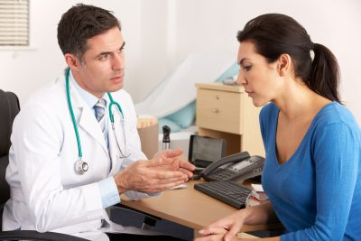 woman talking to doctor about diagnosis