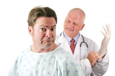 man looking scared of doctor about to do a prostate exam