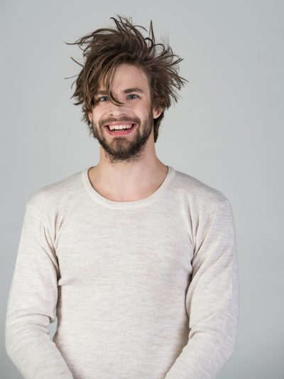 smiling disheveled guy