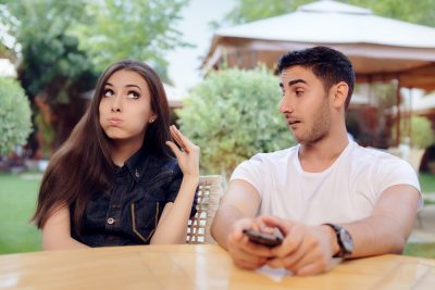 woman tired of listening to his date gestures talking with hand