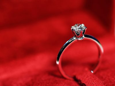 diamond engagement ring on red background
